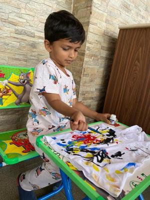 children coloring our world with their paint strokes - IELC Whitefield